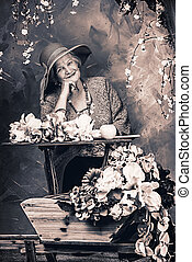 fairy age - Beautiful older woman sitting in the garden...