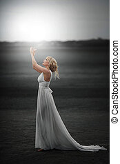 Fairy. Beautiful Girl in White Dress . Magic
