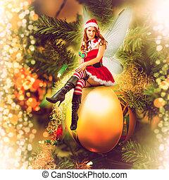 Fairy christmas woman on a decorative ball