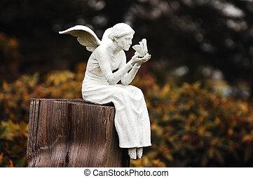 Fairy figurine - White fairy figurine sitting on post