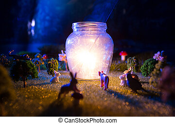 Fairy forest. The animals gathered to see a miracle lamp shining from sparklers. Fictional fairytale macro world
