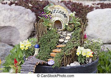 Fairy garden in a flower pot outdoors