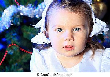 fairy girl - Beautiful child sitting against Christmas...