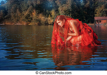 Fairy girl sitting on the water.
