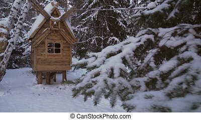 Fairy hut on chicken legs in winter forest stock footage...
