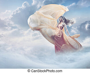 Fairy image of a beautiful young lady in the clouds
