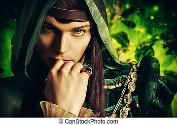 fairy legend - Noble fairy elf in the magic forest. Fantasy...