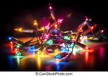 Fairy Lights - Christmas fairy lights isolated on reflecting...