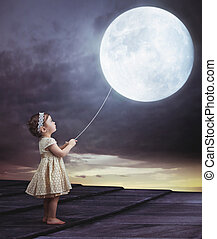 Fairy portait of a little girl with a moony balloon