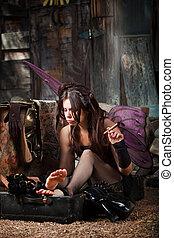 Fairy Smokes Cigar - Lonely fairy in rustic scene smokes a...