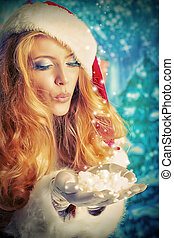 fairy tale - Beautiful young woman in Santa Claus clothes...