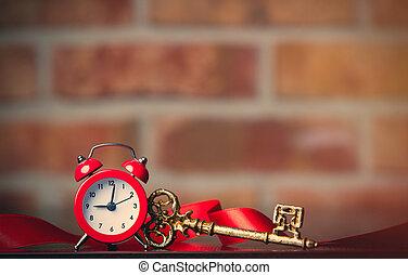 Fairy tale key and retro alarm clock