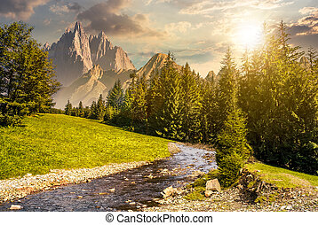 fairy tale mountainous summer landscape at sunset. composite...