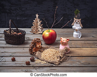 Fairy-tale picture about two toy characters of a hedgehog and a pig, who grazed the grain harvest.