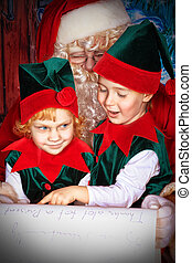 fairy tale - Santa Claus sitting with two little cute elves...