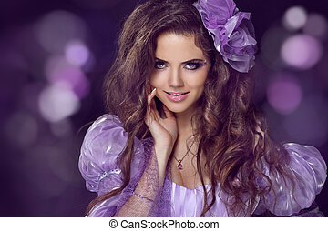 Fairy. Woman with beauty long brown hair. Jewelry and Beauty. Fashion photo studio