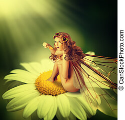 fairy woman with wings sit on chamomile flower