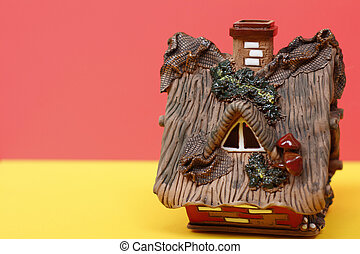 Fairytale house - a hut. The background is bright.