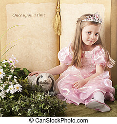 """A beautiful preschool princess petting a bunny before a """"Once upon a time"""" storybook."""