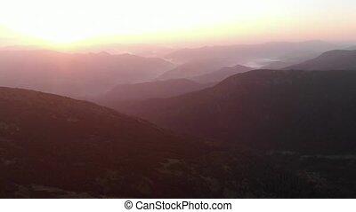 Fairytale sunset over mountain peaks in summer. Carpathian ...