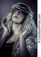 faith concept, woman dressed in white veil and crown of thorns, virgin