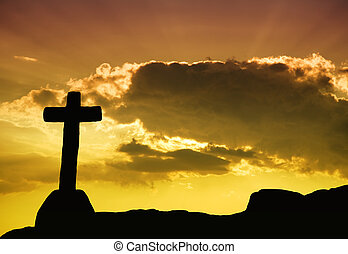 faith - cross silhouette and the clouds at sunset