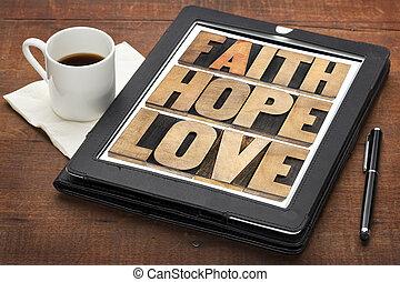 faith, hope and love on digital tablet