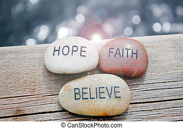 faith, hope, believe rocks - rocks written with the...