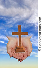 Faith in Hand. - Christian cross in hand in the heavens.