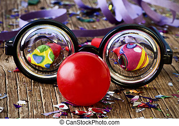 fake eyeglasses, red clown nose and confetti - a pair of ...