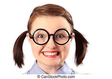 Teenage girl dressed and made-up like a geek.