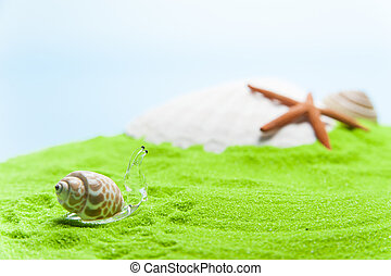 fake glass snail on green sand