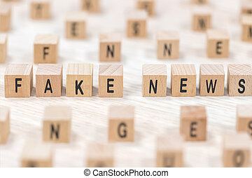 fake news wooden cubes background