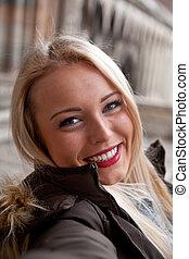 selfie-view of a woman taking a self portrait - fake selfie-...