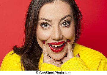 fake smile - beautiful woman with finger forced smile in a...