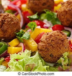 Falafel - fresh falafel with veggies, red onions and salad