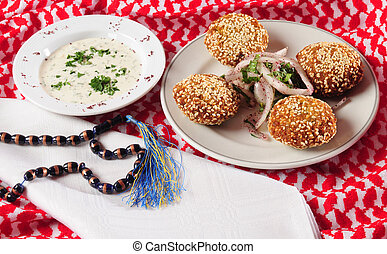 Fried falafel, covered with sesame.
