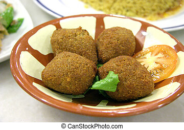 Falafel - Indian muslim dish: four falafels in a bowl with a...