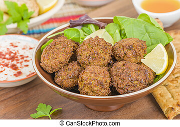 Falafel - Middle Eastern deep fried balls made of chickpeas.