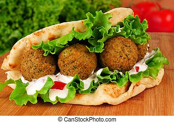 Falafel pita wrap - Falafel with vegetables and tzatziki...