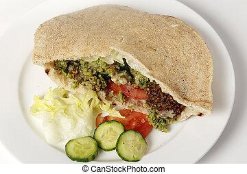 Falafel pocket sandwich with salad - Egyptian flat bread...