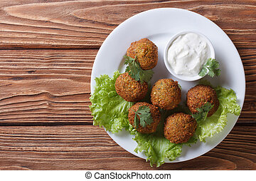 falafel with sauce tzatziki close-up view from above -...