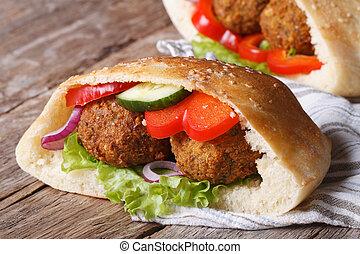 falafel with vegetables in pita bread closeup horizontal -...