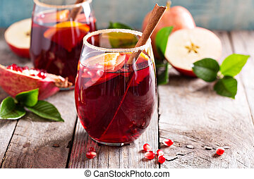 Fall and winter sangria with apples, oranges, pomegranate...