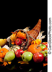 Fall arrangement of fruits and vegetables in a cornucopia -...