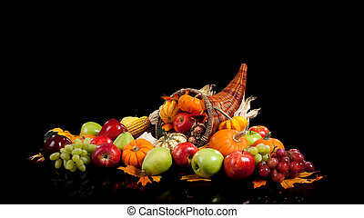 Fall arrangement of fruits and vegetables in a cornucopia - ...
