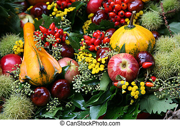 Fall arrangement with fruits and flowers