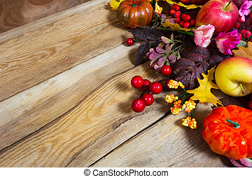 Fall arrangement with pumpkins and pink flowers, copy space