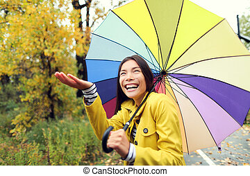 Fall / Autumn concept - woman excited under rain
