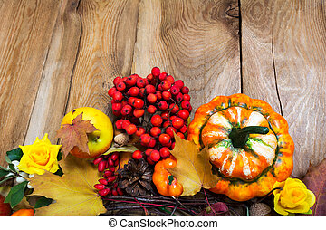 Fall background on the rustic wooden table, copy space
